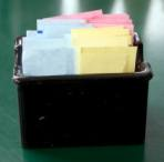 container filled with packets of artificial sweeteners