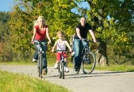 family biking on a nice day