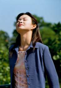 a woman doing a lung cleanse by breathing fresh air in deeply