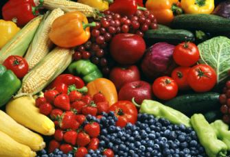 a large variety of raw fruits and vegetables