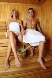 couple enjoying a sauna