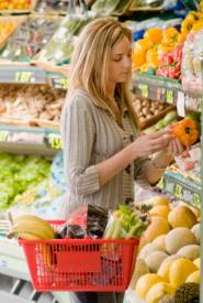 woman selecting healthy foods to boost immune system in a grocery store